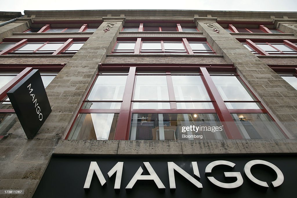 A logo sits on display outside a branch of fashion retailer Mango in Bordeaux, France, on Wednesday, July 17, 2013. Austerity measures and rising unemployment are restraining consumer spending in Europe, while retailers including Groupe Auchan SA and Casino Guichard-Perrachon SA are competing more aggressively on price. Photographer: Balint Porneczi/Bloomberg via Getty Images