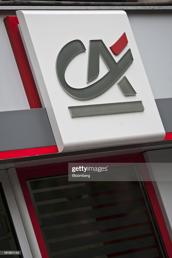 A logo sits on display outside a Credit Agricole SA bank branch in Paris, France, on Thursday, Sept. 19, 2013. Bank of France General Council member Bernard Maris said France will end up restructuring its debt as tax 'optimization' by large companies including Google Inc. will leave too big a burden on the middle class. Photographer: Balint Porneczi/Bloomberg via Getty Images