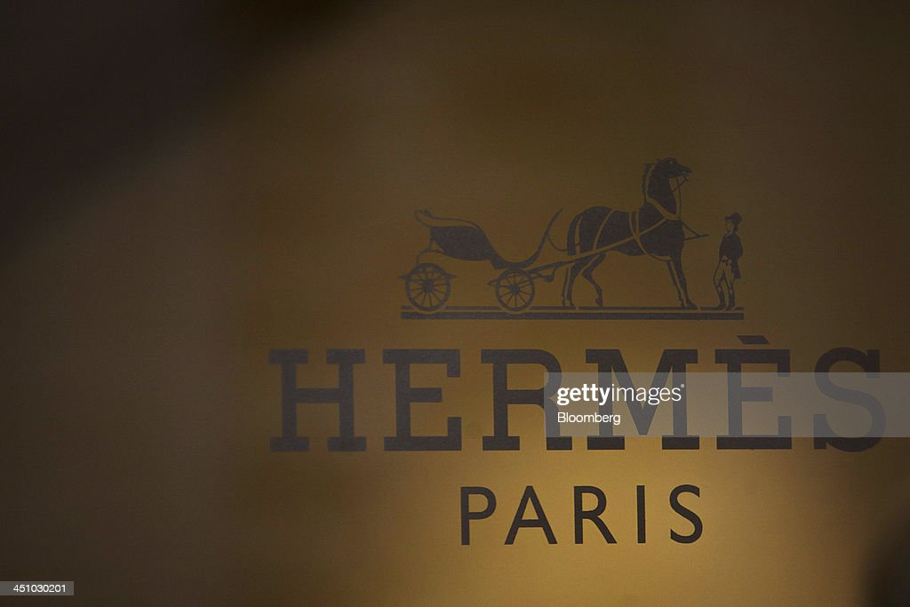A logo sits on display outside a Hermes International SCA luxury fashion clothing store in Toulouse, France, on Wednesday, Nov. 20, 2013. France's gross domestic product fell 0.1 percent in the three months through September, national statistics office Insee said in an e-mailed statement. Photographer: Balint Porneczi/Bloomberg via Getty Images