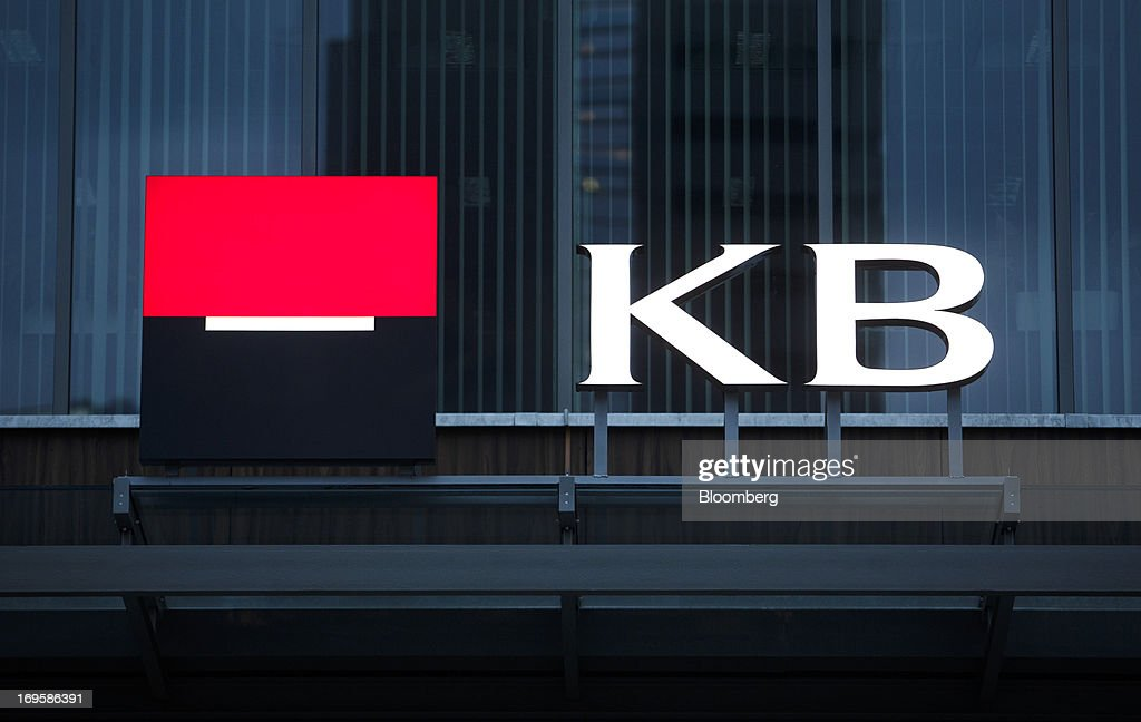 A logo sits on display outside a Komercni Banka AS bank branch in Prague, Czech Republic, on Monday, May 27, 2013. Czech policy makers are in uncharted territory as they debate whether the first koruna sales in a decade are needed to meet their inflation target as the economy has shrunk for five quarters, the longest contraction since at least 1996. Photographer: Martin Divisek/Bloomberg via Getty Images