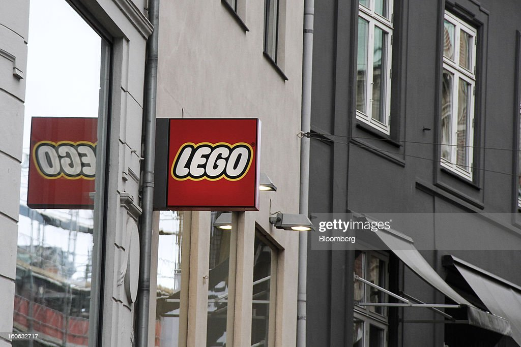 A logo sits on display outside a Lego A/S toy store in Copenhagen, Denmark, on Friday, Jan. 11, 2013. The 'Lego Friends' series, introduced in January in most markets, is Lego's sixth attempt over the years to target girls and the 'most significant' new product in a decade, according to Chief Executive Officer Joergen Vig Knudstorp. Photographer: Freya Ingrid Morales/Bloomberg via Getty Images