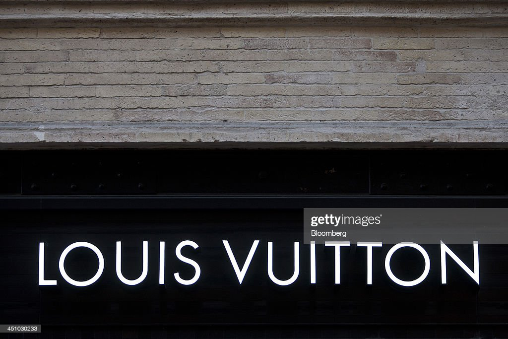 A logo sits on display outside a LVMH Moet Hennessy Louis Vuitton SA luxury retail store in Toulouse, France, on Wednesday, Nov. 20, 2013. France's gross domestic product fell 0.1 percent in the three months through September, national statistics office Insee said in an e-mailed statement. Photographer: Balint Porneczi/Bloomberg via Getty Images