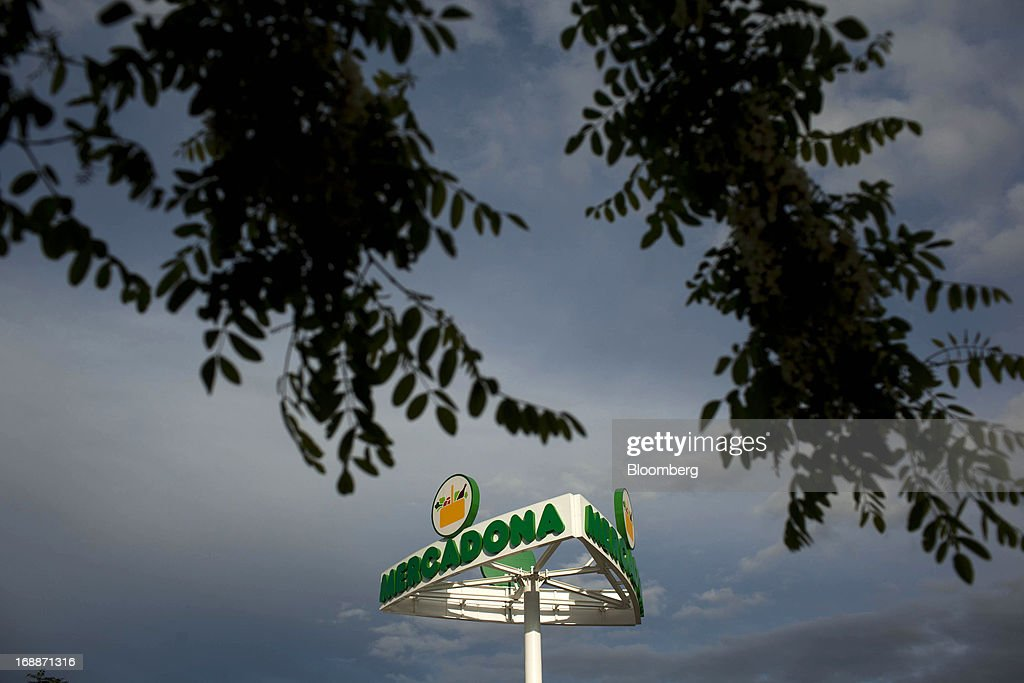 A logo sits on display outside a Mercadona supermarket in Madrid, Spain, on Thursday, May 16, 2014. Billionaires Juan Roig and Hortensia Herrero, the husband-and-wife team that controls Mercadona SA, Spain's largest supermarket chain, created thousands of jobs last year as their country's economy crumbled. Photographer: Angel Navarrete/Bloomberg via Getty Images