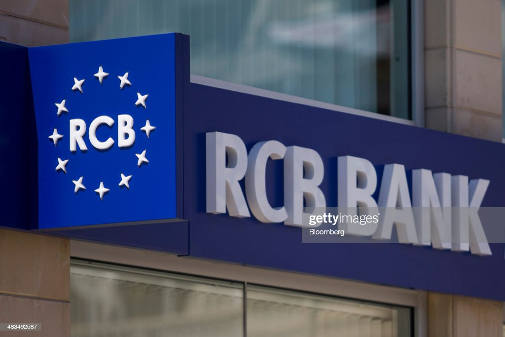 A logo sits on display outside a Russian Commercial Bank Cyprus Ltd. (RCB) bank branch in Limassol, Cyprus, on Tuesday, April 8, 2014. Cyprus wants to shield financial flows with Russia, where it's the biggest foreign investor, as the U.S. and the European Union ratchet up sanctions in response to President Vladimir Putin's annexing Crimea from Ukraine. Photographer: Andrew Caballero-Reynolds/Bloomberg via Getty Images