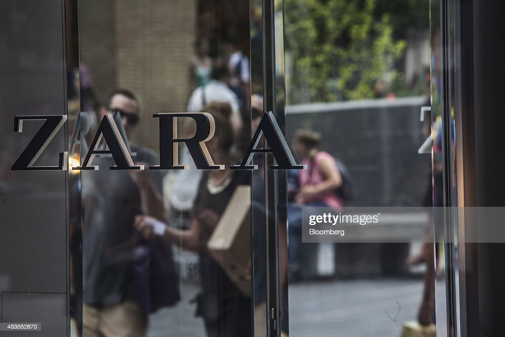 A logo sits on display outside a Zara fashion store, operated by Inditex SA, in Toulouse, in Toulouse, France, on Tuesday, Aug. 12, 2014. The euro traded 0.3 percent from a nine-month low before reports this week that may show growth in the region weakened and inflation slowed, adding to signs the bloc's economy is struggling to recover. Photographer: Balint Porneczi/Bloomberg via Getty Images