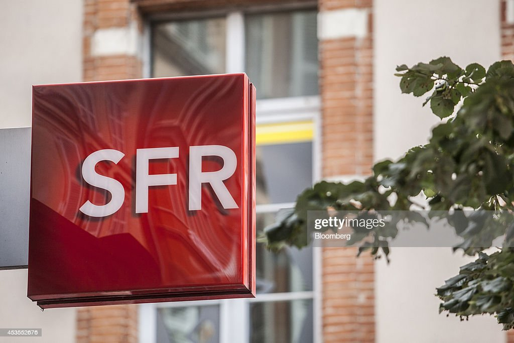 A logo sits on display outside an SFR mobile phone store, operated by SFR SA, a unit of Vivendi SA, in Toulouse, France, on Tuesday, Aug. 12, 2014. The euro traded 0.3 percent from a nine-month low before reports this week that may show growth in the region weakened and inflation slowed, adding to signs the bloc's economy is struggling to recover. Photographer: Balint Porneczi/Bloomberg via Getty Images
