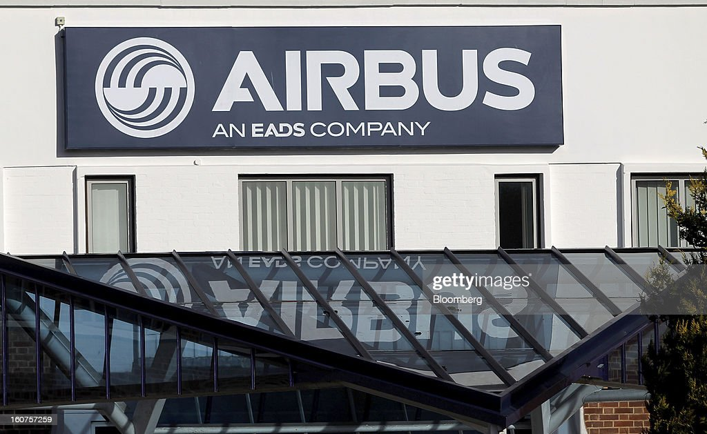 A logo sits on display outside the Airbus wing assembly factory in Broughton, U.K., on Monday, Feb. 4, 2013. Airbus SAS won a $9 billion order from Steven Udvar-Hazy's Air Lease Corp. that includes 25 A350 wide-body jets, a competitor to Boeing Co.'s grounded 787 Dreamliner. Photographer: Paul Thomas/Bloomberg via Getty Images