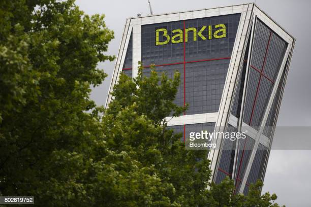 A logo sits on display outside the headquarters of Bankia SA in one of the Kio towers in Madrid on Wednesday June 28 2017 Bankia SA agreed to...