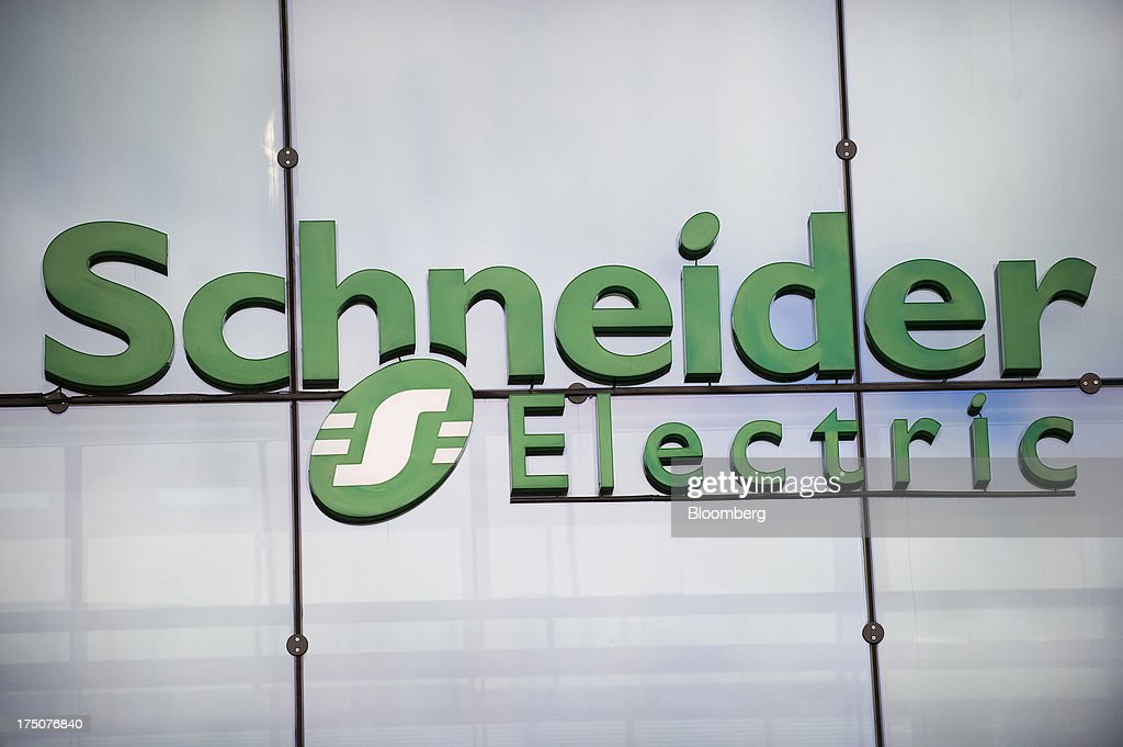 schneider electric logo. a logo sits on display outside the headquarters of schneider electric sa in rueil-malmaison