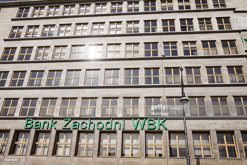 A logo sits on display outside the main regional office for Bank Zachodni WBK SA in Wroclaw, Poland, on Monday, March 25, 2013. KBC Groep NV of Belgium and Banco Santander SA of Spain raised 4.89 billion zloty ($1.51 billion) from the sale of a stake in Bank Zachodni WBK SA, Poland's third-largest lender. Photographer: Bartek Sadowski/Bloomberg via Getty Images