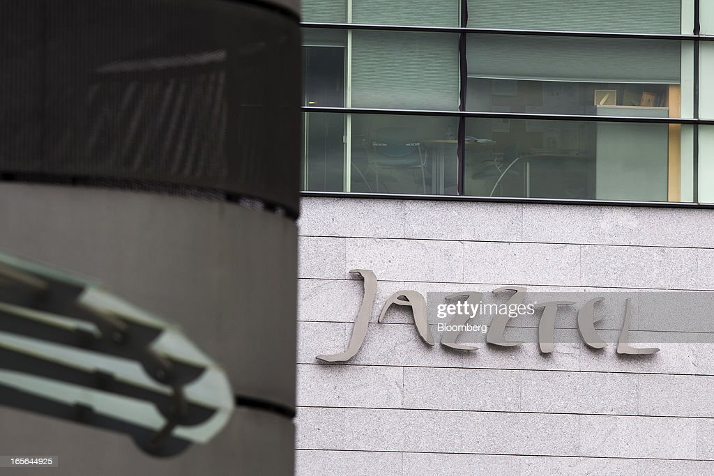 A logo sits on display outside the offices of Jazztel Plc in Alcobendas, Spain, on Thursday, April 4, 2013. Jazztel almost doubled its share of the Spanish broadband market from 2009 to 2012 as it focused mostly on the fixed-telephone business through a reliable and affordable product that has gained popularity among debt-strapped Spaniards. Photographer: Angel Navarrete/Bloomberg via Getty Images