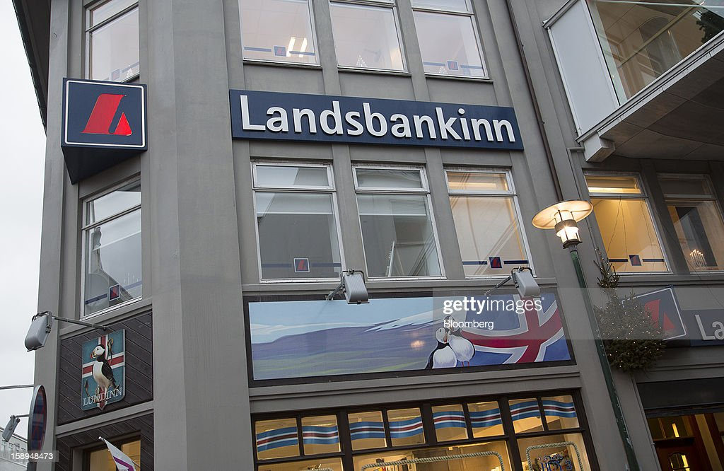 A logo sits on display outside the offices of the Landsbankinn hf bank in Reykjavik, Iceland, on Wednesday, Jan. 2, 2013. Creditors of Iceland's three biggest failed banks are fighting for a waiver to krona controls imposed in 2008 amid risks pay-outs will be delayed beyond 2015. Photographer: Arnaldur Halldorsson/Bloomberg via Getty Images