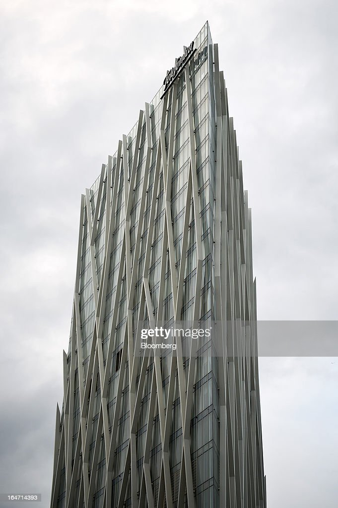 A logo sits on display outside the Telefonica-Diagonal Zero tower, headquarters of Telefonica Digital in Barcelona, Spain, on Tuesday, March 26, 2013. Telefonica, seeking to reduce net debt by more than 4 billion euros this year, is following companies such as Repsol SA, Spain's biggest oil company, and builder Actividades de Construccion & Servicios SA, to sell treasury shares. Photographer: David Ramos/Bloomberg via Getty Images