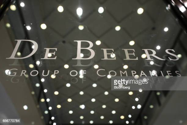 A logo sits on the door of the reception area of the De Beers SA headquarters on Charterhouse Street in London UK on Wednesday Feb 1 2017 Number 17...