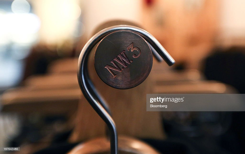 A logo sits on the end of a clothes rail inside a NW3 store, a brand of Hobbs and former pop-up store, in London, U.K., on Tuesday, Nov. 27, 2012. Fashion chain Hobbs is among those that have opened pop-up stores for the first time this year, while CD and DVD retailer HMV Group Plc is adding more than usual for the holiday in an effort to win business. Photographer: Chris Ratcliffe/Bloomberg via Getty Images