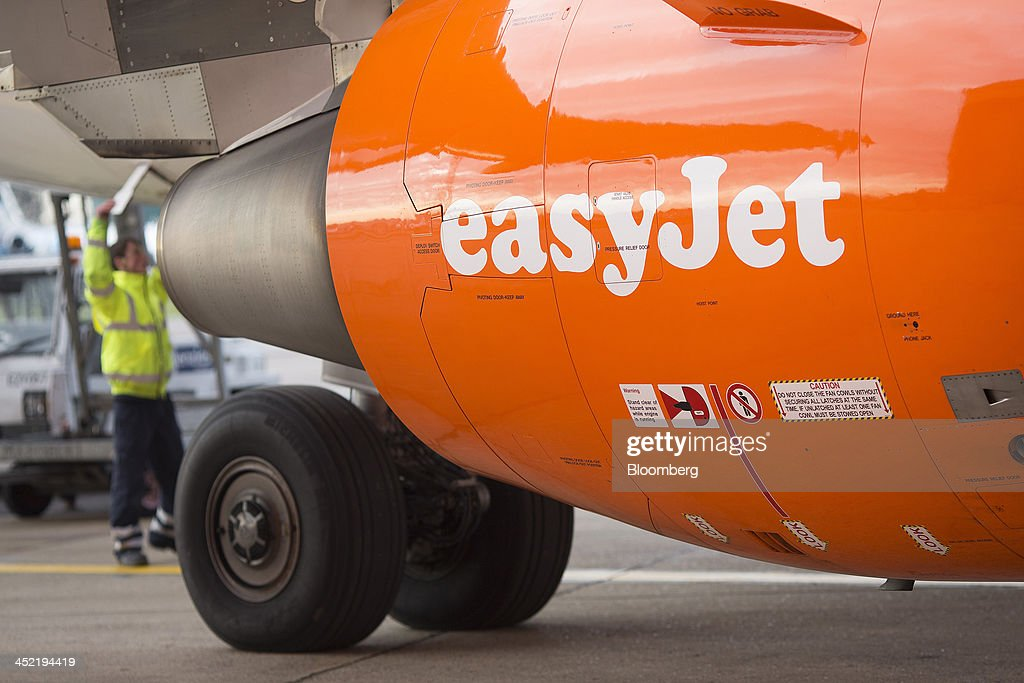 A logo sits on the engine cowling of an aircraft operated by EasyJet Plc, at the airline's hub at London Luton Airport in Luton, U.K., on Tuesday, Nov. 26, 2013. Shares in International Consolidated Airlines Group SA (IAG) and EasyJet Plc climbed at least 2 percent, pushing a gauge of travel and leisure companies higher, as oil prices slid in reaction to Iran's nuclear deal with world powers. Photographer: Simon Dawson/Bloomberg via Getty Images
