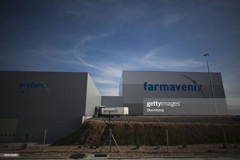 A logo sits on the exterior of the Farmavenix distribution depot, part of the Cofares SA plant in Guadalajara, Spain, on Wednesday, Jan. 30, 2013. Madrid, the second-biggest contributor to Spain's economy after Catalonia, has sliced 1 billion euros from its budget in 2012, increasing public-transportation costs and university fees, cutting jobs, delaying investments and reducing health-care and social benefits. Photographer: Angel Navarrete/Bloomberg via Getty Images