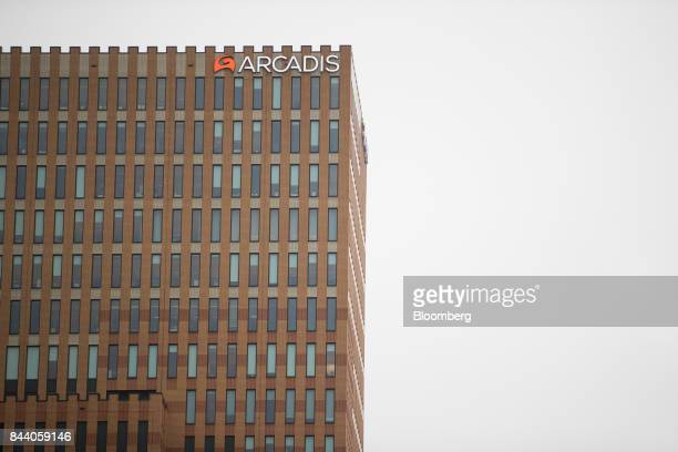 A logo sits on the exterior of the headquarter offices of Arcadis NV in the Zuidasfinancial district of Amsterdam Netherlands on Friday Sept 8 2017...