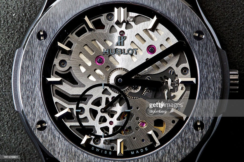 A logo sits on the face of a Classic Fusion Classico Ultra-Thin Skeleton All Black wristwatch, manufactured by Hublot SA, a watchmaking unit of LVMH Moet Hennessy Louis Vuitton SA, during the Baselworld watch fair in Basel, Switzerland, on Thursday, April 25, 2013. The annual fair attracts 2,000 companies from the watch, jewelry and gem industries to show their new wares to more than 100,000 visitors. Photographer: Gianluca Colla/Bloomberg via Getty Images