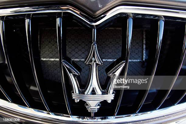 A logo sits on the front grille of a new Quattroporte V8 automobile produced by Maserati the luxuryauto maker owned by Fiat SpA during its debut in...