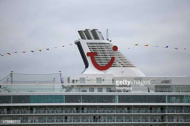 A TUI logo sits on the funnels of the Mein Schiff 4 cruise ship operated by TUI AG at Hamburg port in Hamburg Germany on Tuesday June 2 2015...