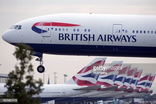 A logo sits on the fuselage of a British Airways aircraft a unit of International Consolidated Airlines Group SA as it prepares to land at Heathrow...