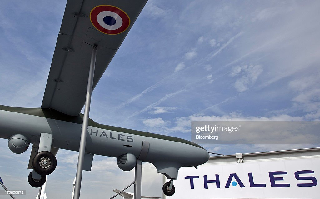 A logo sits on the fuselage of a Thales SA unmanned air vehicle (UAV) or drone, outside the company's stand on the second day of the Paris Air Show in Paris, France, on Tuesday, June 18, 2013. The 50th International Paris Air Show is the world's largest aviation and space industry show, and takes place at Le Bourget airport June 17-23. Photographer: Balint Porneczi/Bloomberg via Getty Images