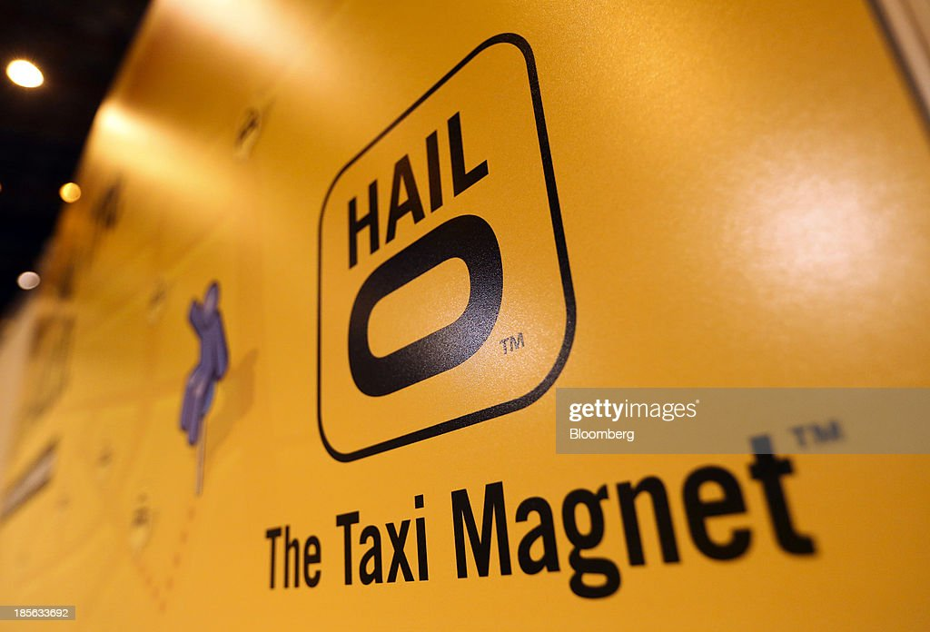 A logo sits on the Hailo Network Ltd. taxi app stand during the Apps World Multi-Platform Developer Show in London, U.K., on Wednesday, Oct. 23, 2013. Retail sales of Internet-connected wearable devices, including watches and eyeglasses, will reach $19 billion by 2018, compared with $1.4 billion this year, Juniper Research said in an Oct. 15 report. Photographer: Chris Ratcliffe/Bloomberg via Getty Images