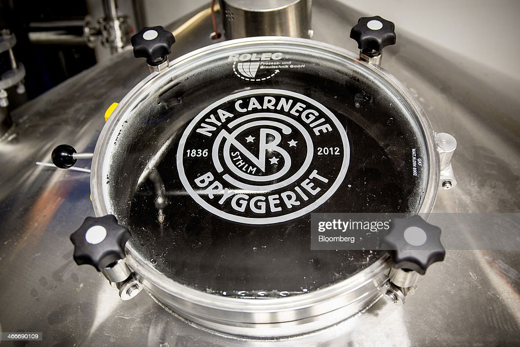 A logo sits on the hatch of a beer brewing vat at the 'New Carnegie Brewery,' also known as Nya Carnegibryggeriet, operated by Brooklyn Brewery Corp. in collaboration with D. Carnegie & Co., the Swedish unit of Carlsberg A/S, stands in Stockholm, Sweden, on Friday, Jan. 31, 2014. Brooklyn has teamed up with the Swedish unit of Carlsberg A/S, D. Carnegie & Co. and a few private investors to create 'The New Carnegie Brewery,' with an annual capacity of 1 million liters. Photographer: Casper Hedberg/Bloomberg via Getty Images