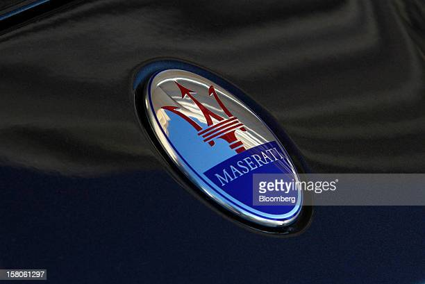 A logo sits on the hood of a new Quattroporte V8 automobile produced by Maserati the luxuryauto maker owned by Fiat SpA during its debut in Nice...