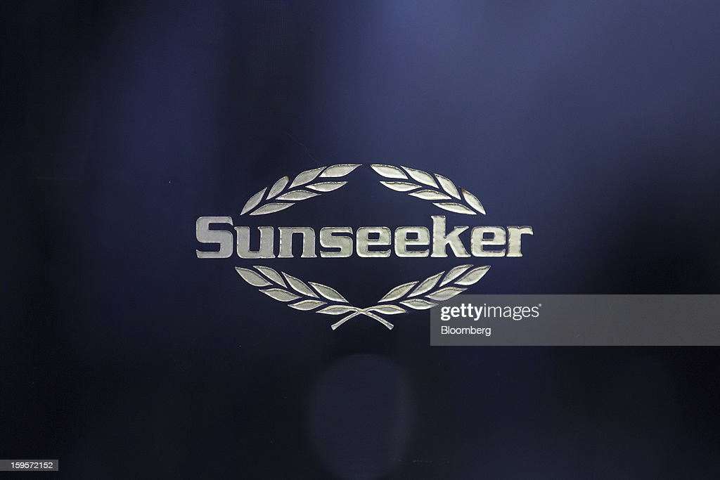 A logo sits on the hull of a luxury yacht manufactured by Sunseeker International Ltd., during the Tullet Prebon London Boat Show 2013 at the ExCeL center in London, U.K., on Wednesday, Jan. 16, 2013. The show, Europe's first in 2013, will showcase new sailing craft from dinghies to luxury yachts, and runs Jan. 12-20. Photographer: Simon Dawson/Bloomberg via Getty Images
