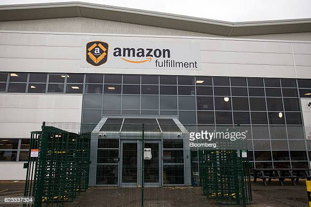 A logo sits on the outside of an Amazoncom Inc fulfillment center in Peterborough UK on Tuesday Nov 15 2016 The online retail giant needs smart...