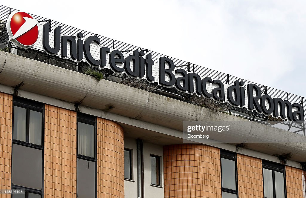 A logo sits on the roof of a UniCredit SpA bank branch in Viterbo, Italy, on Monday, March 11, 2013. Intesa Sanpaolo SpA and UniCredit SpA are among Italian banks due to report losses for the fourth quarter this week, as the economic contraction meant more clients failed to repay their debts. Photographer: Alessia Pierdomenico/Bloomberg via Getty Images