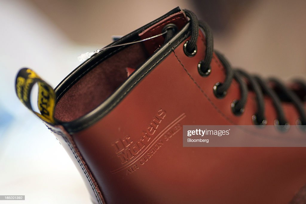 A logo sits on the side of a Dr. Martens boot inside a footwear store in London, U.K., on Friday, Oct. 18, 2013. Permira Advisers LLP, the London-based private-equity firm that owns clothing brand Hugo Boss, is in advanced talks to buy iconic British punk-boot maker Dr. Martens, said a person with knowledge of the negotiations. Photographer: Simon Dawson/Bloomberg via Getty Images