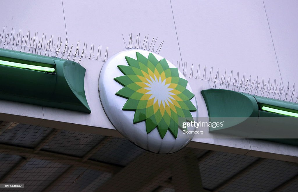 A logo sits on the side of a roof at a BP gas station, operated by BP Plc, in Upminster, U.K., on Thursday, Feb. 28, 2013. BP Plc's push to maximize profits and cut costs at the Macondo well was a 'root cause' of the explosion that led to the 2010 Gulf of Mexico oil spill, a safety expert who studied the disaster said. Photographer: Chris Ratcliffe/Bloomberg via Getty Images