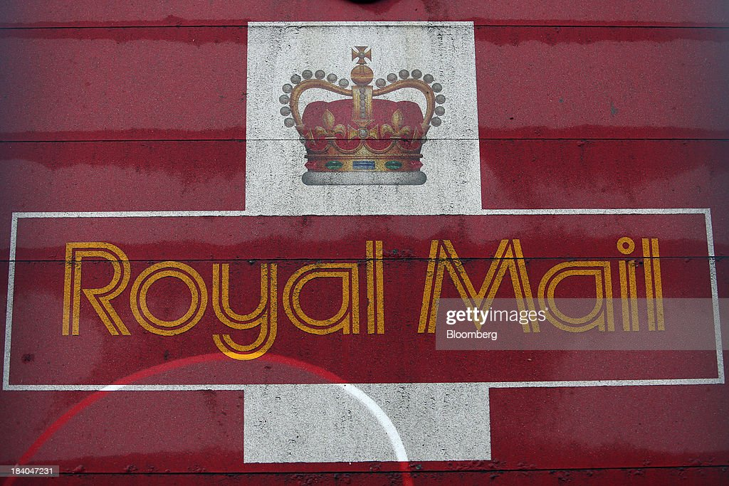 A logo sits on the side of a Royal Mail Group Ltd. delivery truck at the company's postal sorting office in Romford, U.K., on Friday, Oct. 11, 2013. Royal Mail Group Ltd., Britain's 360-year-old postal service, jumped as much as 38 percent on its trading debut, heightening criticism of an initial public offering that opposition politicians say was underpriced. Photographer: Chris Ratcliffe/Bloomberg via Getty Images