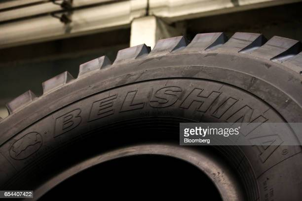 A logo sits on the sidewall of a large 4000R57 sized tire in the control room at the Belshina JSC tire factory in Babruysk Belarus on Thursday March...