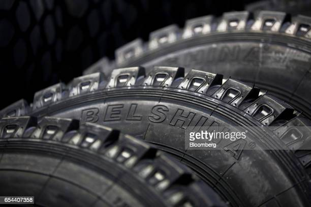 A logo sits on the sidewall of industrial use rubber tires at the Belshina JSC tire factory in Babruysk Belarus on Thursday March 16 2017 Belshina...