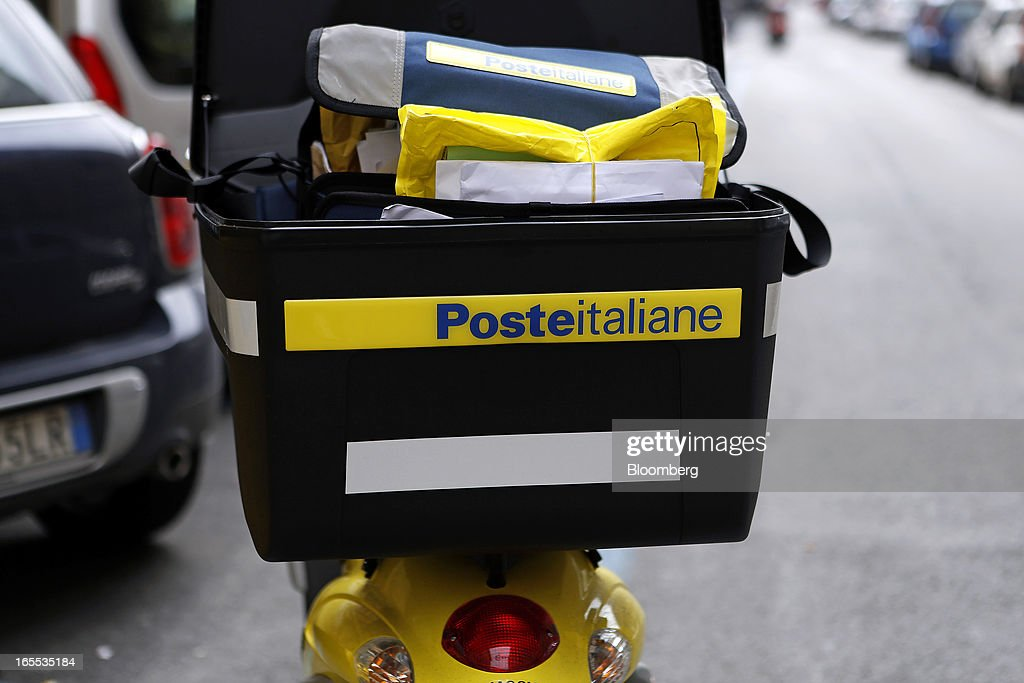 A logo sits on the top box of a Poste Italiane SpA delivery scooter parked outside a post office in Rome, Italy, on Thursday, April 4, 2013. Italy's state-owned postal service and Wind SpA, the country's third-largest mobile-phone company, are discussing a possible venture with Wind's fixed-line network Infostrada, Poste Italiane SpA Chief Executive Officer Massimo Sarmi said. Photographer: Alessia Pierdomenico/Bloomberg via Getty Images