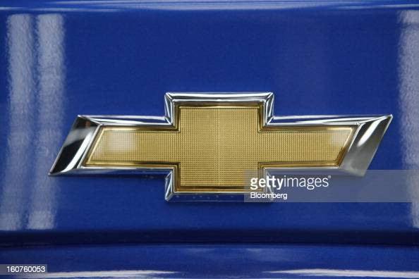 A logo sits on the trunk of a Chevrolet Aveo automobile a division of General Motors Co on the production line at the GAZ Group plant in Niznhy...