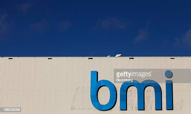 A BMI logo sits on the wall of the company's hangar at Heathrow airport in London UK on Thursday Dec 22 2011 British Airways parent IAG sealed the...