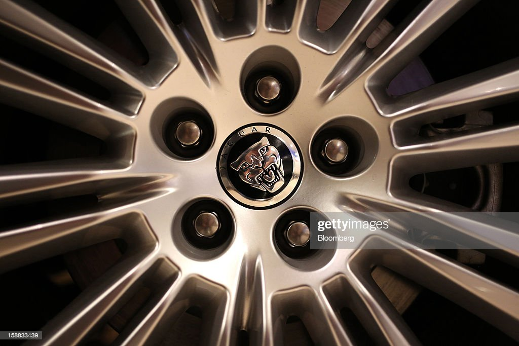 A logo sits on the wheel hub of a Jaguar automobile for sale in a Jaguar Land Rover auto dealership in Moscow, Russia, on Thursday, Dec. 27, 2012. Tata Motors Ltd.'s Jaguar Land Rover luxury unit signed a letter of intent with Saudi Arabia's government to study the feasibility of setting up a factory to build its models locally. Photographer: Andrey Rudakov/Bloomberg via Getty Images