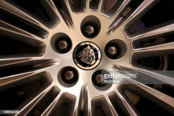 A logo sits on the wheel hub of a Jaguar automobile for sale in a Jaguar Land Rover auto dealership in Moscow Russia on Thursday Dec 27 2012 Tata...