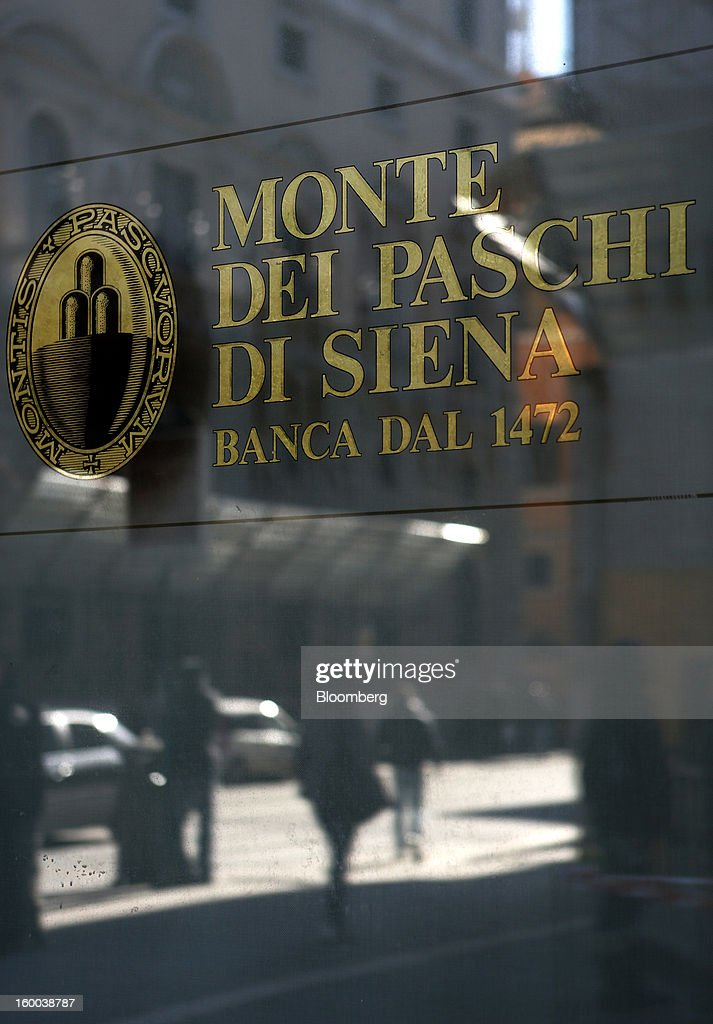 A logo sits on the window of a Banca Monte dei Paschi di Siena SpA bank branch in Rome, Italy, on Friday, Jan. 25, 2013. Italian Prime Minister Mario Monti said the Bank of Italy will take another look at Banca Monte dei Paschi di Siena SpA's books after the company disclosed this week it may face more than 700 million euros of losses related to structured finance transactions hidden from regulators. Photographer: Alessia Pierdomenico/Bloomberg via Getty Images