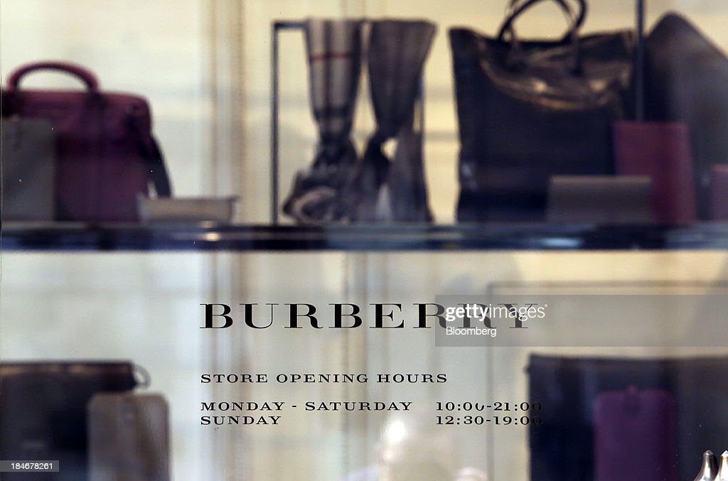 A logo sits on the window of a display outside Burberry Group Plc's luxury clothing store on Regent Street in London, U.K., on Tuesday, Oct. 15, 2013. Burberry named Christopher Bailey as chief executive officer to succeed Angela Ahrendts who will leave in 2014 to work as a senior vice president at Apple Inc. Photographer: Chris Ratcliffe/Bloomberg via Getty Images