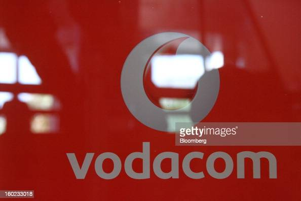 A logo sits on the window of a Vodacom store inside Vodaworld the headquarters of Vodacom Group Ltd Vodafone's biggest African business in...