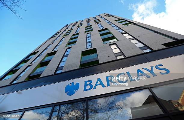 A logo sits outside a Barclays Plc bank branch in Barking UK on Friday Feb 7 2014 Barclays Plc reported fullyear profit that missed analyst estimates...