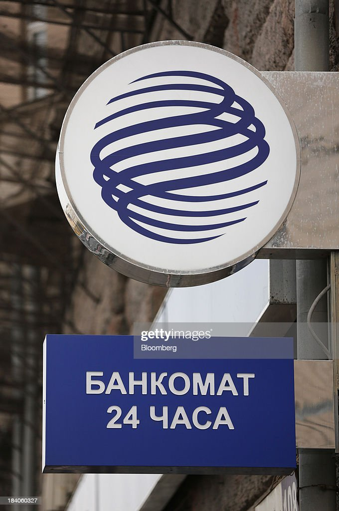 A logo sits outside a Gazprombank OJSC bank branch in Moscow, Russia, on Friday, Oct. 11, 2013. Tinkoff Credit Systems is valued at $2.5b to $3b for London IPO, which reflects P/E multiple of 9.5 to 11.4, Vedomosti reports, citing unidentified people familiar with offering documents. Photographer: Andrey Rudakov/Bloomberg via Getty Images