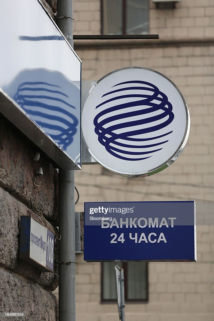 A logo sits outside a Gazprombank OJSC bank branch in Moscow, Russia, on Friday, Oct. 11, 2013. Tinkoff Credit Systems Bank, operated by TCS Group Holding Plc, is valued at $2.5b to $3b for London IPO, which reflects P/E multiple of 9.5 to 11.4, Vedomosti reports, citing unidentified people familiar with offering documents. Photographer: Andrey Rudakov/Bloomberg via Getty Images