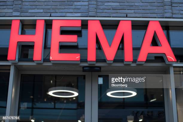 A logo sits outside a Hema BV store in Tilburg Netherlands on Wednesday Oct 4 2017 Privateequity firm Lion Capital LLP which bought the chain a...